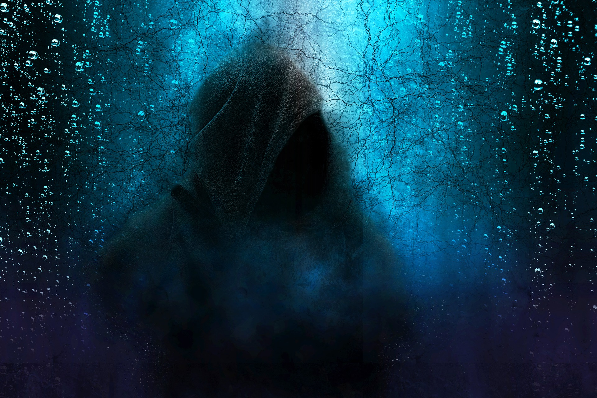 Hooded figure against dark blue background